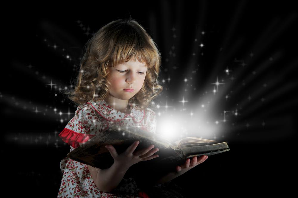 girl-reading-magical-book